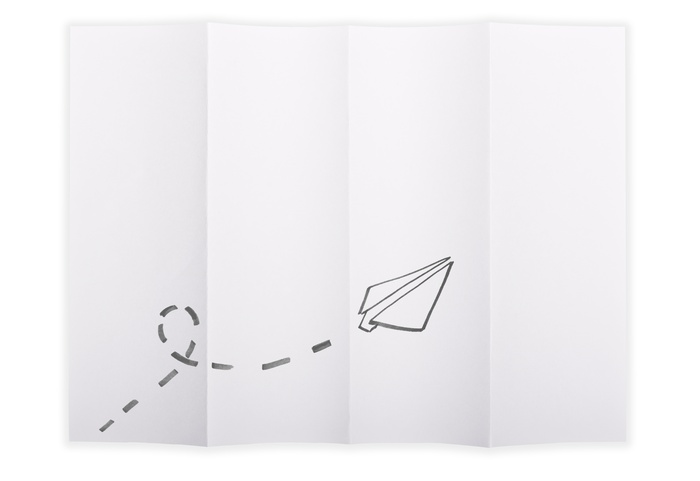 White paper sheet folded in 4 quarters isolated over a white background with a paper airplane sketched on it