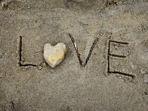 """Love"" spelled in the sand"