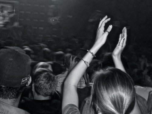 Person clapping hands in a crowd of people