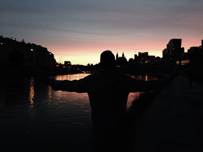 Person standing infront of a sunset