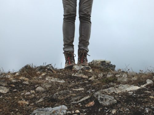 Hiker standing on hill
